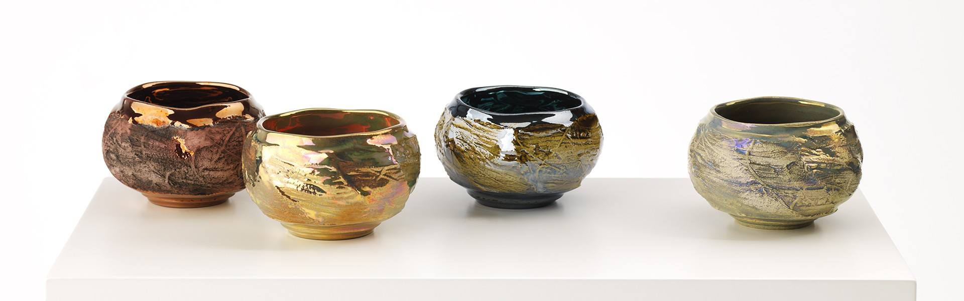 Textured Faceted Bowls glazed with in glaze lustre inspired by frozen water